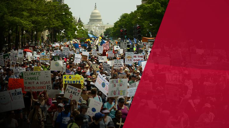 Climate change protesters march in Washington DC