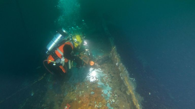 Divers securely drill into and access the oil tanks of the wreck of the British-flagged tanker Coimbra, May 8, 2019. The Coimbra was a supply ship owned by Great Britain when the ship was sunk off the coast of Long Island, during World War II by a German U-boat. (U.S. Coast Guard photo courtesy of Sector Long Island Sound)