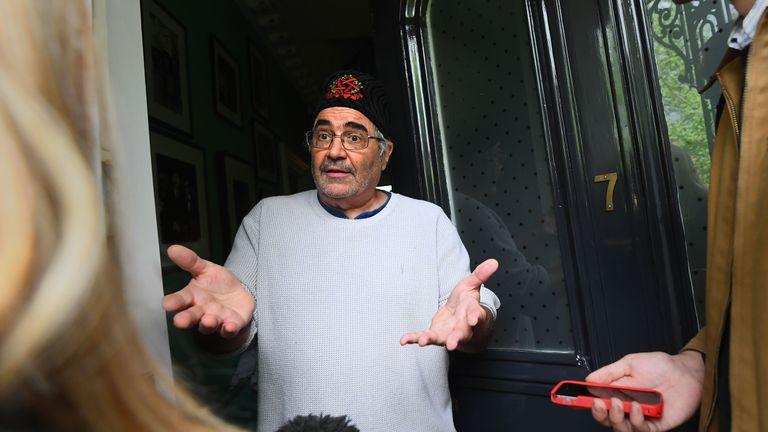 Baker spoke to reporters outside his London home on Thursday