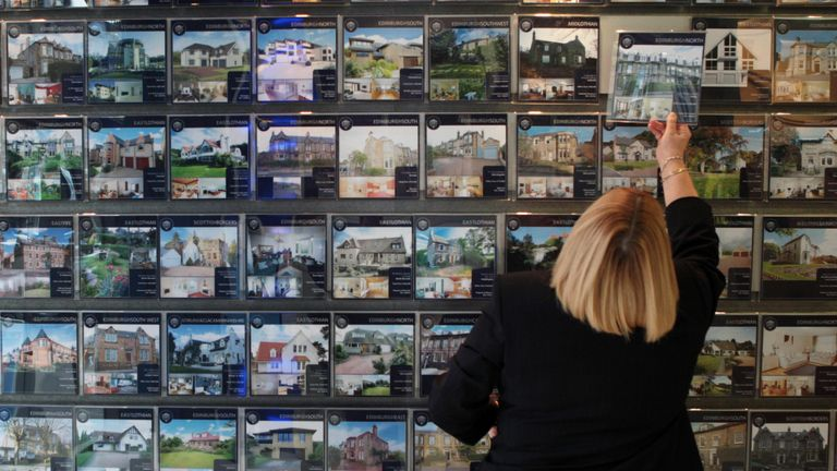 A staff member looks at some of the houses for sale around Edinburgh at the Property Centre in Edinburgh