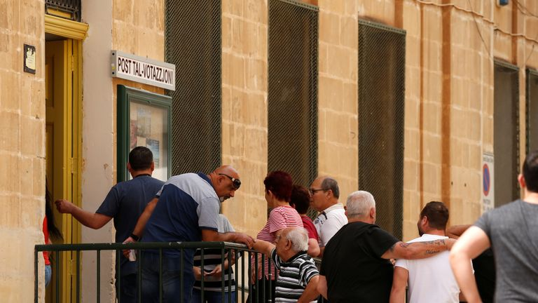 Voters queue at a polling station in Malta