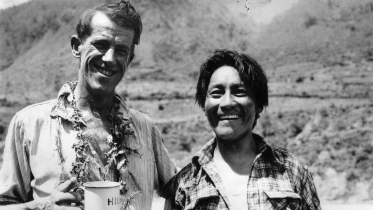 Edmund Hillary and Sherpa Tensing  were the first men to conquer Everest