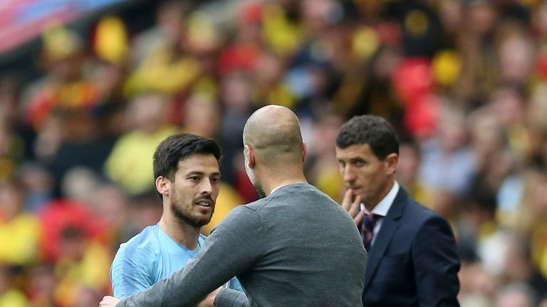 Pep Guardiola congratulates David Silva as he leaves the pitch