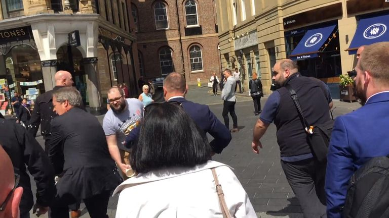 The Brexit Party leader was left drenched after the attack and berated his security while being whisked away to a car