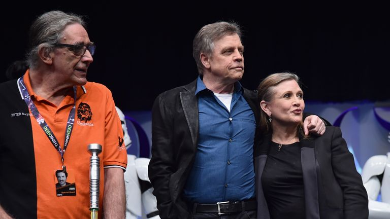 Actors Peter Mayhew, Mark Hamill and Carrie Fisher speak onstage during Star Wars Celebration 2015 on April 16, 2015 in Anaheim, California