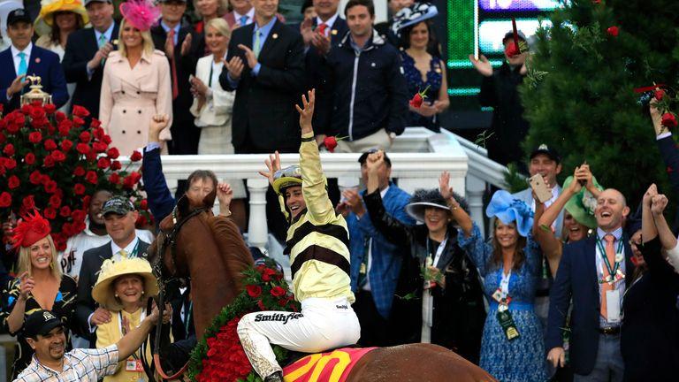 Jockey Flavien Prat celebrates after winning the race
