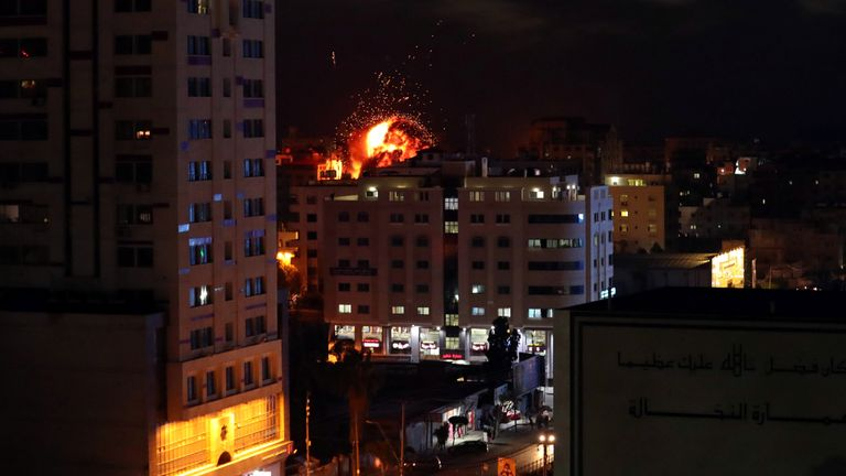 TOPSHOT - An explosion is pictured among buildings during an Israeli airstike on Gaza City on May 4, 2019. - Gaza militants fired a barrage of rockets at Israel, which responded with airstrikes, officials said, as a fragile ceasefire again faltered. (Photo by Mahmud Hams / AFP) (Photo credit should read MAHMUD HAMS/AFP/Getty Images)
