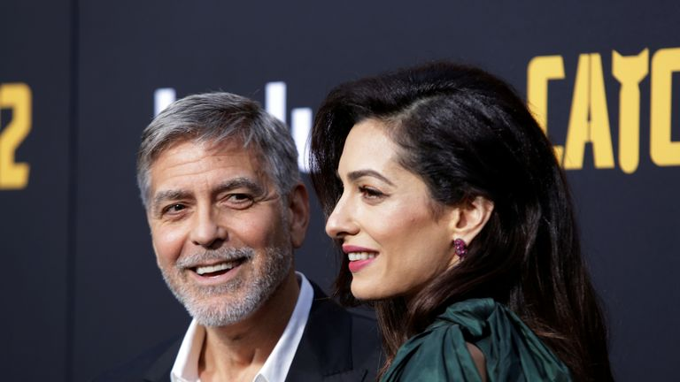 George and Amal Clooney offer fans the chance to dine with