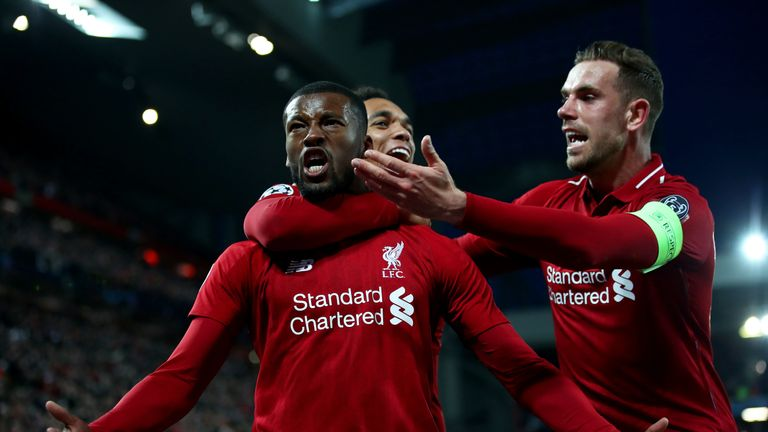 Wijnaldum is mobbed by his teammates after levelling the tie