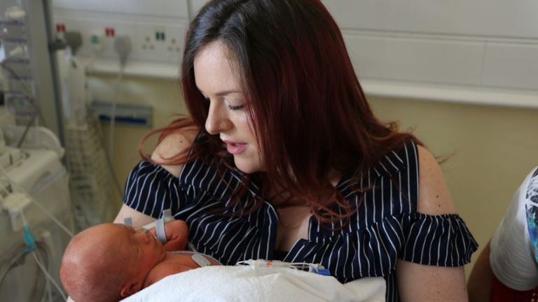 Sherrie Sharp, pictured with her son Jaxson, was one of the first to have the pioneering surgery at King's