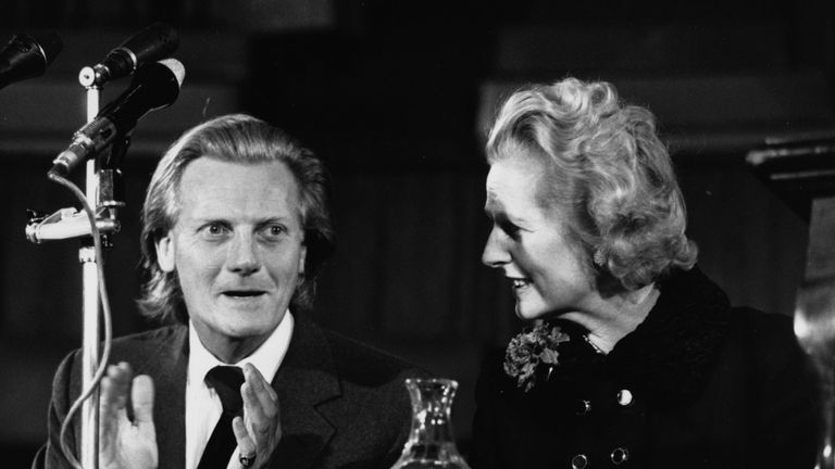Conservative Party leader Margaret Thatcher and Shadow Trade Minister Michael Heseltine speaking at a rally organized by the Chamber of Trade, at Central Hall in Westminster, London, February 17th 1975. (Photo by Wesley/Keystone/Getty Images)