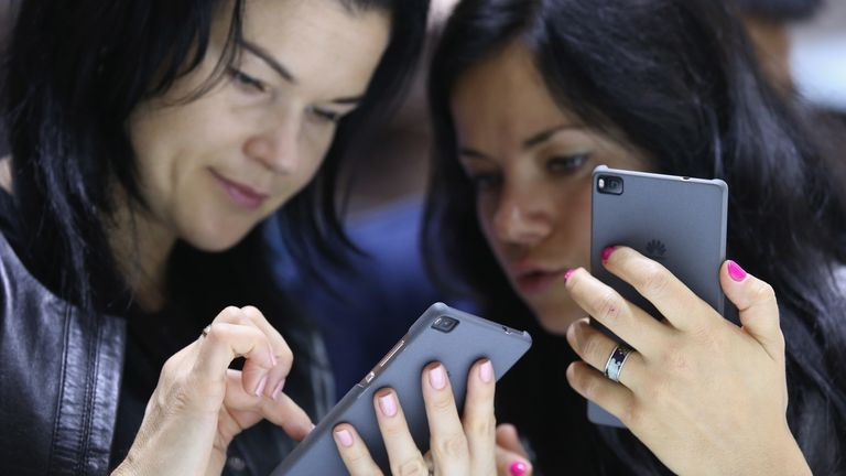 BERLIN, GERMANY - SEPTEMBER 04: Visitors try out the Honor 7 smartphone at the Huawei stand at the 2015 IFA consumer electronics and appliances trade fair on September 4, 2015 in Berlin, Germany. The 2015 IFA will be open to the public from September 4-9. (Photo by Sean Gallup/Getty Images)