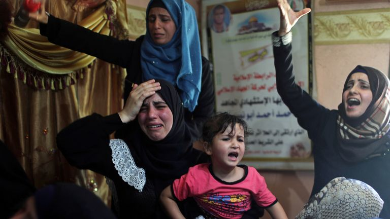 Palestinians mourn the death of a family member killed during a protest at the border between Israel and Gaza