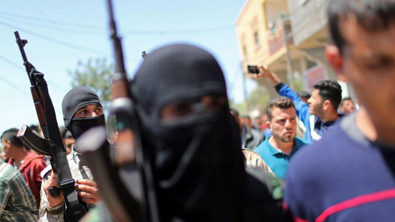 Palestinian militants take part in the funeral of a comrade killed by an Israeli airstrike