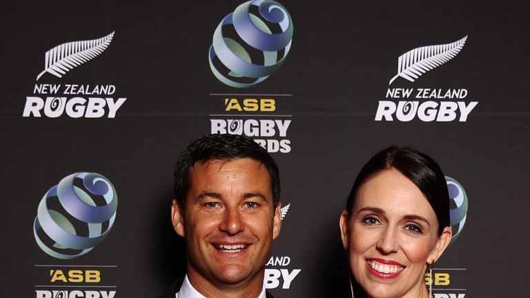 Prime Minister Jacinda Ardern and her partner Clarke Gayford pose on the red carpet during the 2018 ASB Rugby Awards at SkyCity Convention Centre on December 13, 2018 in Auckland, New Zealand
