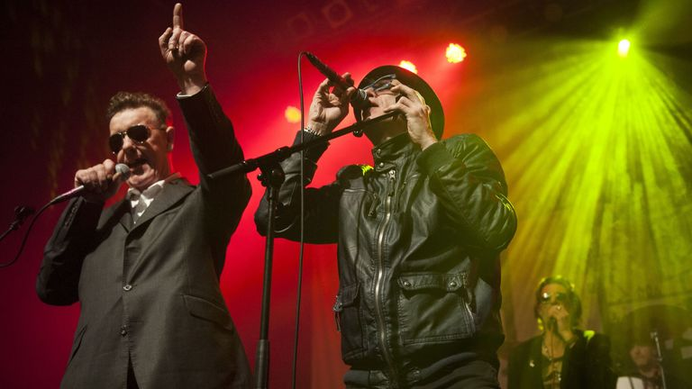 Jake Black (L), performing with The Alabama 3 in Glasgow in 2015