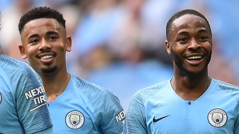 Raheem Sterling (R) celebrates with Gabriel Jesus