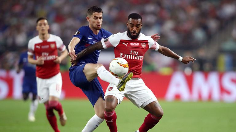 Chelsea's Jorginho and Arsenal's Lacazette compete for the ball
