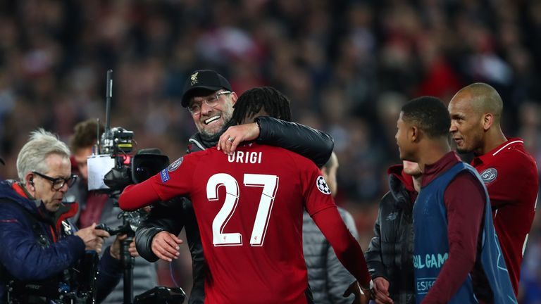 Manager Jurgen Klopp celebrates with match-winner Origi