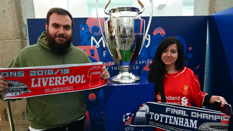 Fans pose with the UEFA Champions League trophy after it was unveiled in Madrid ahead of the final
