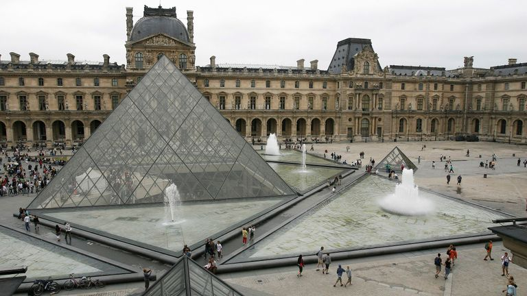 The Louvre Museum with its glass Pyramid entrance designed by I.M. Pei in Paris, France