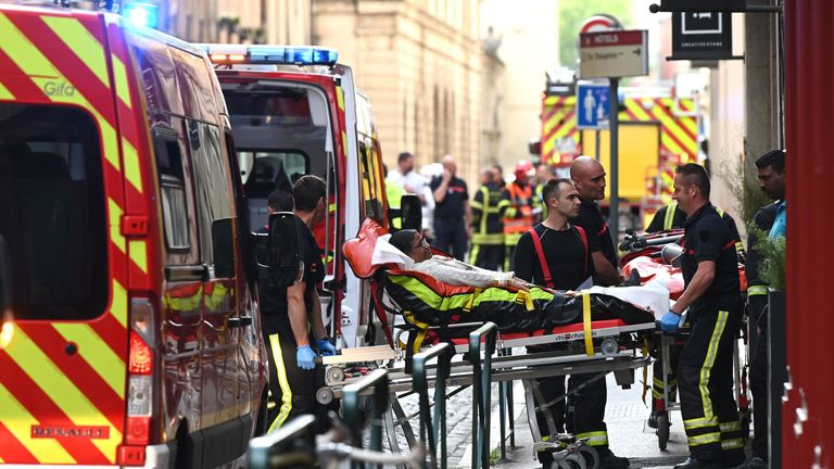 A woman is stretchered away after the explosion left seven people injured
