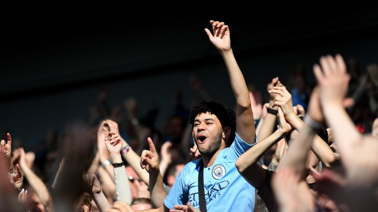 City fans celebrate after the final whistle