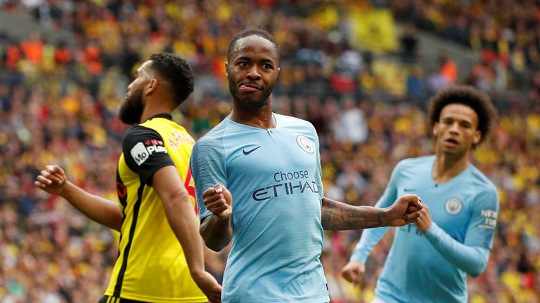 Raheem Sterling celebrates scoring their fifth goal