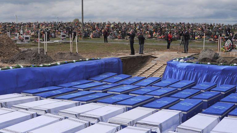 People attend a ceremony to rebury the remains of Jews killed by Nazis in a local ghetto during World War Two, which were recently found at a construction site in a residential area, in the city of Brest, Belarus May 22, 2019. REUTERS/Stringer NO RESALES. NO ARCHIVES.