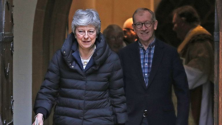 Prime Minister Theresa May (left) leaves with her husband Philip after attending a church service near her Maidenhead constituency