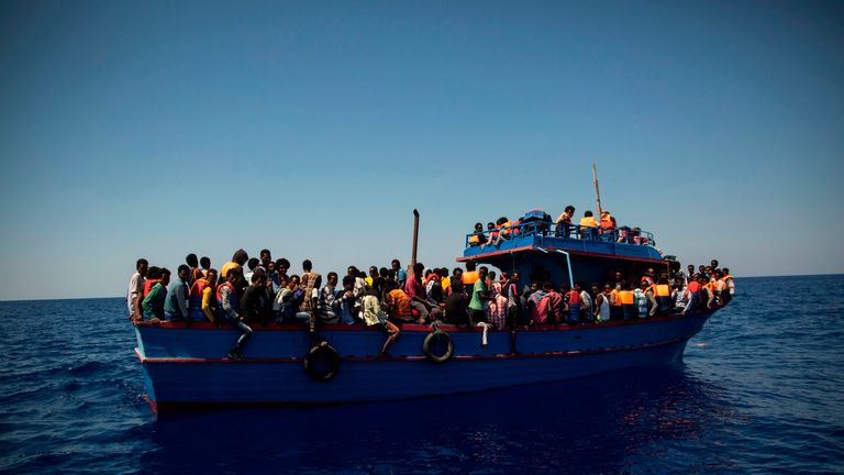 Migrants wait to be rescued in the Mediterranean