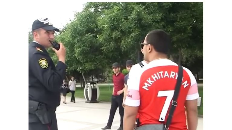 info for 05a50 912be Arsenal fans wearing Henrikh Mkhitaryan shirts stopped by ...