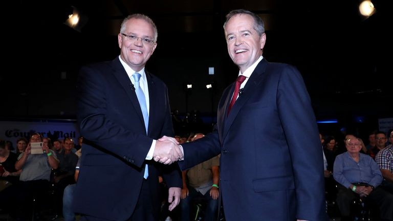 In this handout image provided by News Corp Australia, Prime Minister Scott Morrison and the Opposition Leader Bill Shorten shake hands before the Sky News/Courier Mail People's Forum on May 3, 2019 in Brisbane, Australia