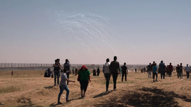 Tear gas is fired by IDF soldiers to stop protesters from getting too close to the fence
