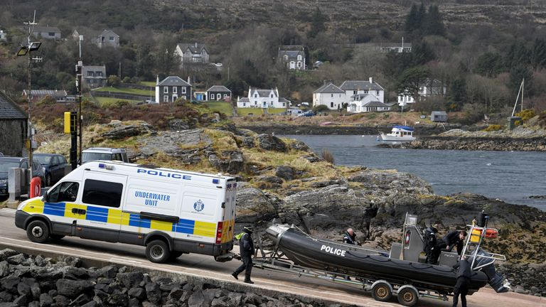 A police under water rescue unit launches a boat into Loch Fyne where the Nancy Glen sank