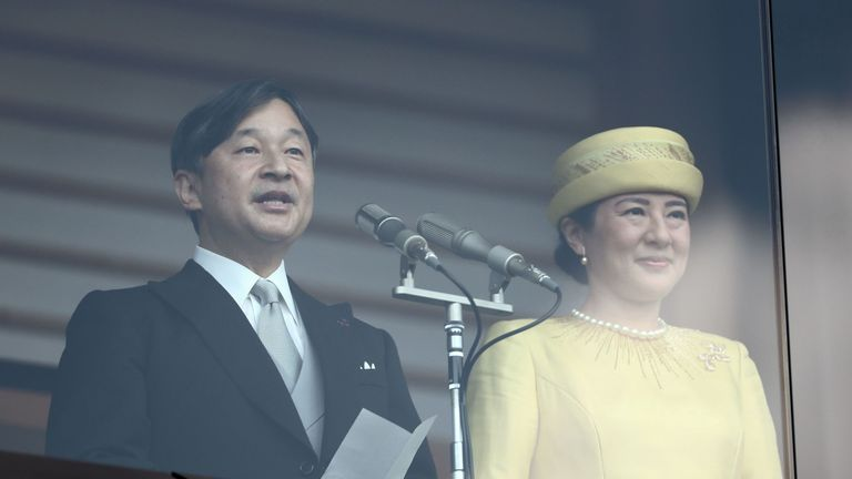 Japan's Emperor Naruhito (L) reads a statement as he and Empress Masako (R) make their first public appearance after ascending to the throne, at the Imperial Palace in Tokyo on May 4, 2019