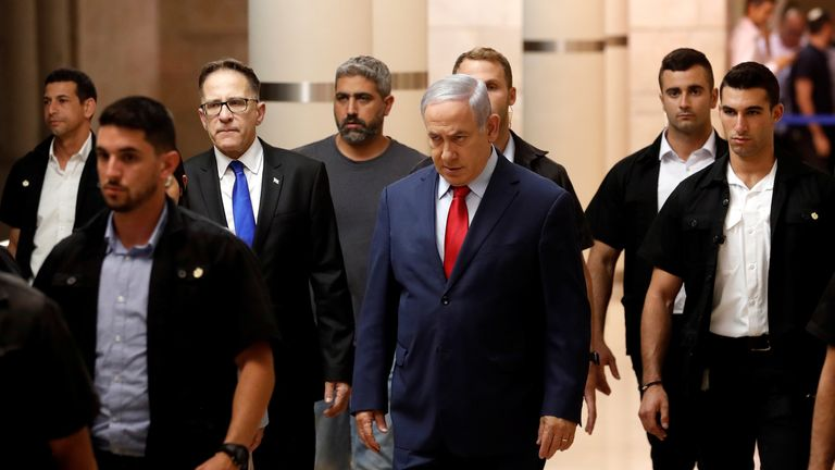 Benjamin Netanyahu arrives at a Likud party meeting