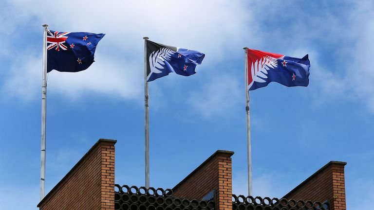 AUCKLAND, NEW ZEALAND - DECEMBER 14: The current New Zealand flag (L) the referendum winning blue and black Kyle Lockwood designed flag (C) and the second placed red and blue flag (R) fly on a building in New Lynn, Auckland on December 14, 2015 in Auckland, New Zealand. New Zealanders voted on December 12 for a possible replacement to their current flag. (Photo by Fiona Goodall/Getty Images)