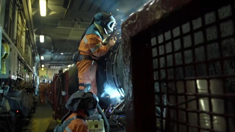 Workers welding sections of Nord Stream 2