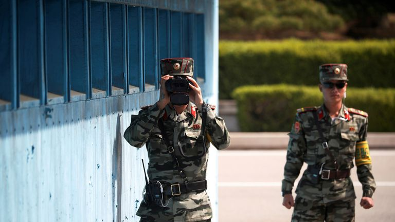 A North Korean soldier keeps watch toward the south through a binocular telescope at the truce village of Panmunjom inside the demilitarized zone (DMZ) separating the two Koreas, South Korea, May 1, 2019. REUTERS/Kim Hong-Ji