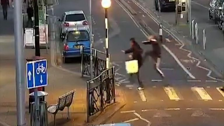 CCTV: Elderly man assaulted as people walk by