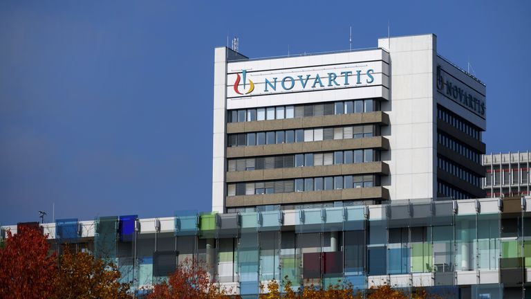 A sign of Swiss pharmaceutical giant Novartis is seen on the top of a building at the company's campus on October 27, 2015 in Basel. Novartis said that its third-quarter net profit fell by 42 percent to $1.8 billion (1.64 billion euros), partially due to provisions to settle a US corruption case. However the world's largest pharmaceutical company in terms of sales confirmed its 2015 targets, including sales growth from continuing operations in mid-single digits excluding exchange rate effects an