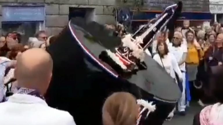 A woman has died after suffering a neck injury during the traditional May Day Obby Oss celebration in Padstow, Cornwall.