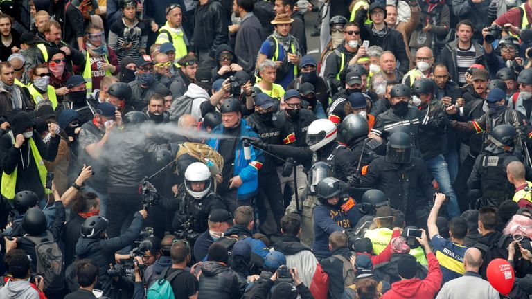 An estimated 7,400 riot police are in Paris