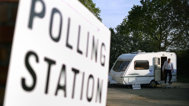 A man leaves after casting his vote in a caravan being used as a polling station on a farm in Garthorpe near Melton Mowbray, in Leicestershire, as voters head to the polls for the European Parliament election.