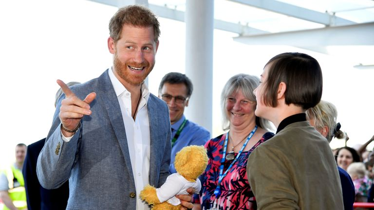 Prince Harry, Duke of Sussex, receives a teddy bear from  former patient Daisy Wingrove as he visits Oxford Children's Hospital