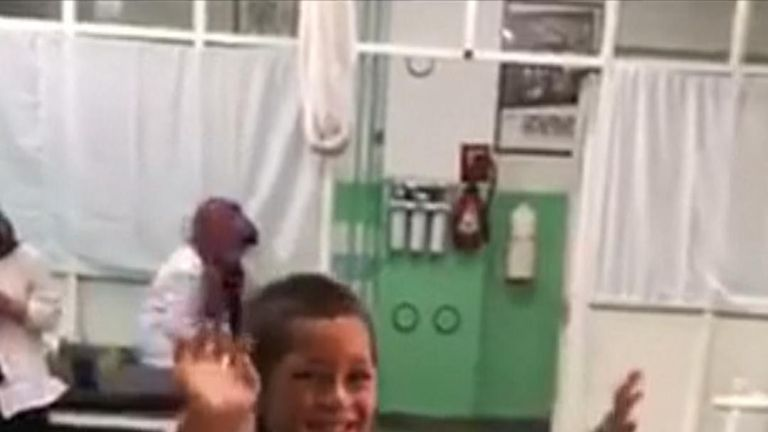 Boy with prosthetic leg dances with joy