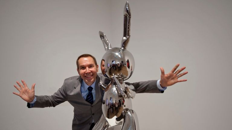 U.S. artist Jeff Koons poses with his artwork Rabbit 1986 at the launch of the Pop Life : Art in a Modern World exhibition at the Tate Modern in London September 29, 2009