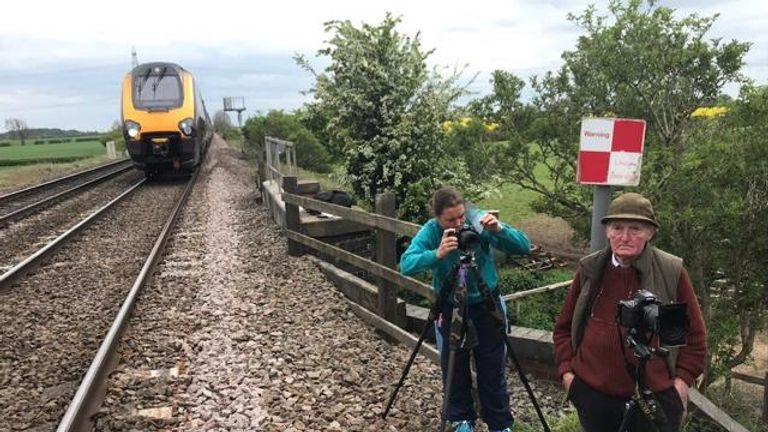 Two trespassers were pictured next to the tracks trying to spot the Flying Scotsman. Pic: BTP