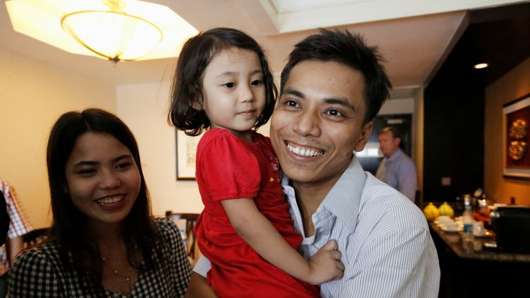 Reuters reporter Kyaw Soe Oo celebrates with wife Chit Su Win and his daughter